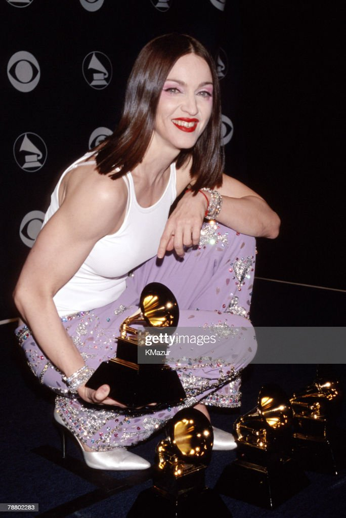 <a gi-track='captionPersonalityLinkClicked' href=/galleries/search?phrase=Madonna+-+Singer&family=editorial&specificpeople=156408 ng-click='$event.stopPropagation()'>Madonna</a>