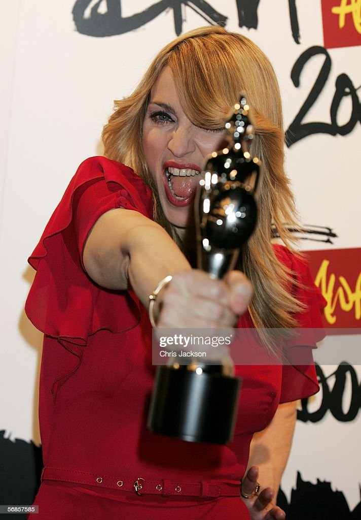 <a gi-track='captionPersonalityLinkClicked' href=/galleries/search?phrase=Madonna+-+Singer&family=editorial&specificpeople=156408 ng-click='$event.stopPropagation()'>Madonna</a> poses in the Awards Room with the award for International Female Solo Artist at The Brit Awards 2006 with MasterCard at Earls Court 1 on February 15, 2006 in London, England. The 26th annual music awards highlight the achievements of the UK record industry with all proceeds donated to the British Record Industry Trust (BRIT).