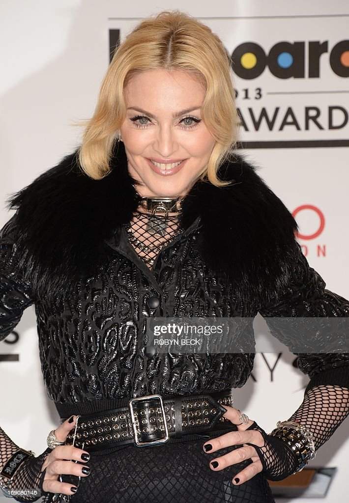 Madonna poses in the press room at the 2013 Billboard Music Awards at the MGM Grand in Las Vegas Nevada May 19 2013 AFP PHOTO / ROBYN BECK