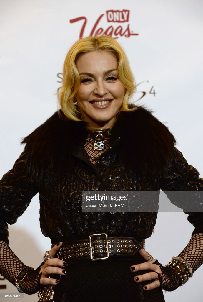 <a gi-track='captionPersonalityLinkClicked' href=/galleries/search?phrase=Madonna+-+Singer&family=editorial&specificpeople=156408 ng-click='$event.stopPropagation()'>Madonna</a> poses in the press room during the 2013 Billboard Music Awards at the MGM Grand Garden Arena on May 19, 2013 in Las Vegas, Nevada.