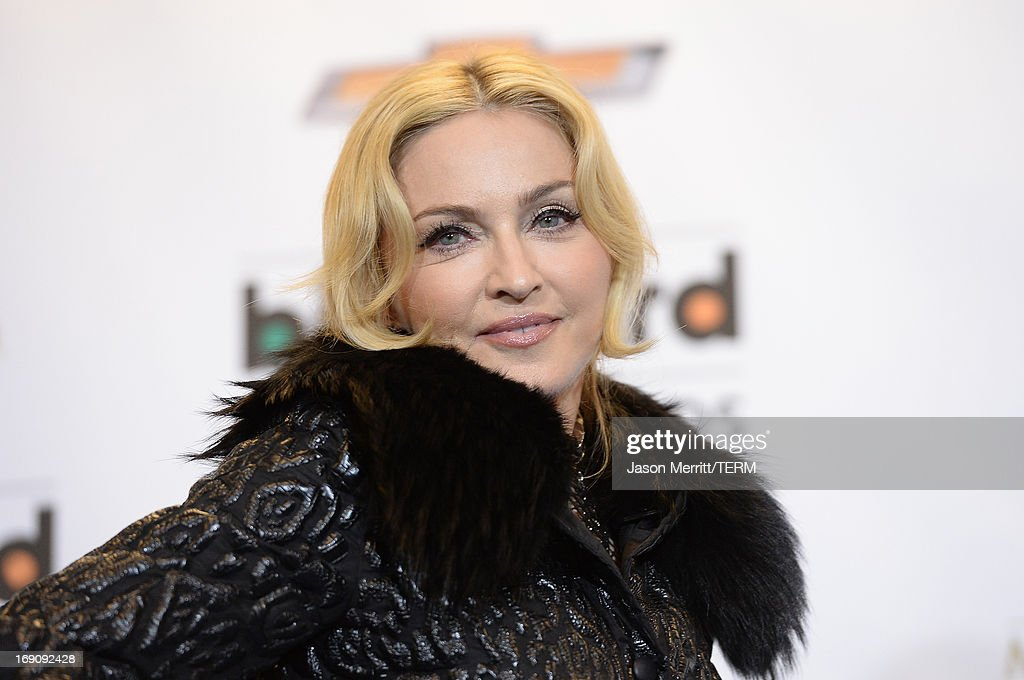 Madonna poses in the press room during the 2013 Billboard Music Awards at the MGM Grand Garden Arena on May 19 2013 in Las Vegas Nevada