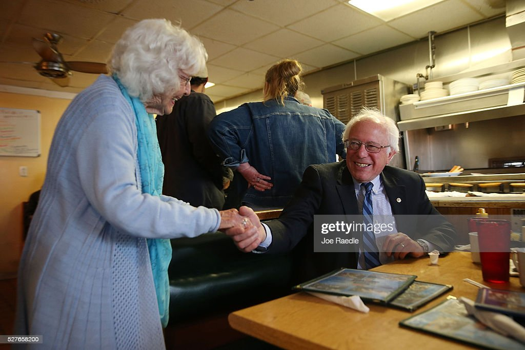 Madonna Rea shakes hands with Democratic presidential candidate <a gi-track='captionPersonalityLinkClicked' href=/galleries/search?phrase=Bernie+Sanders&family=editorial&specificpeople=2908340 ng-click='$event.stopPropagation()'>Bernie Sanders</a> (D-VT) as he has breakfast at Peppy Grill on May 3, 2016 in Indianapolis, Indiana. Indiana voters went to the polls today as they decide who to cast their ballot for during the states primary election.