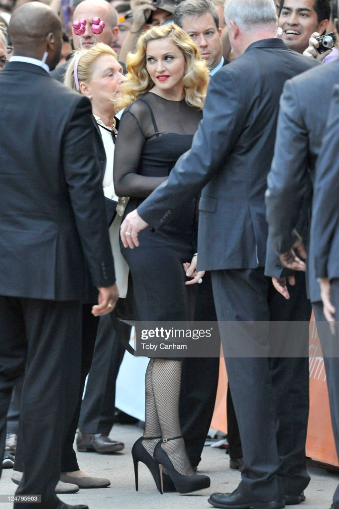 <a gi-track='captionPersonalityLinkClicked' href=/galleries/search?phrase=Madonna+-+Singer&family=editorial&specificpeople=156408 ng-click='$event.stopPropagation()'>Madonna</a> seen arriving for the premiere of her film 'WE' on the streets of Toronto on September 12, 2011 in Toronto, Canada.