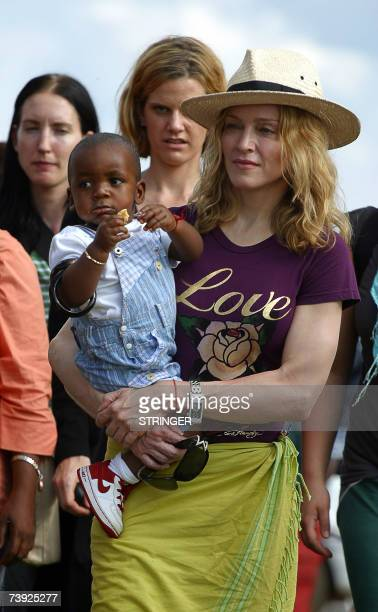 Madonna the 'Queen of Pop' poses with her Malawian son David Banda in Mphandula 19 April 2007 Madonna urged Malawian youths to work hard to realise...