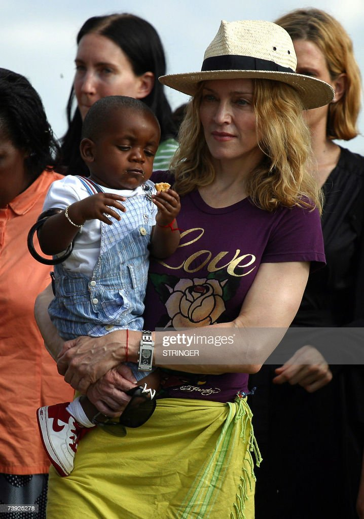 <a gi-track='captionPersonalityLinkClicked' href=/galleries/search?phrase=Madonna+-+Singer&family=editorial&specificpeople=156408 ng-click='$event.stopPropagation()'>Madonna</a> the 'Queen of Pop', poses with her Malawian son <a gi-track='captionPersonalityLinkClicked' href=/galleries/search?phrase=David+Banda&family=editorial&specificpeople=3962330 ng-click='$event.stopPropagation()'>David Banda</a> in Mphandula 19 April 2007 <a gi-track='captionPersonalityLinkClicked' href=/galleries/search?phrase=Madonna+-+Singer&family=editorial&specificpeople=156408 ng-click='$event.stopPropagation()'>Madonna</a> urged Malawian youths to work hard to realise their potential. 'Keep working hard. I hope you realise how much power you have to make a good future for yourselves,' the US singer, told scores of cheering and dancing villagers when she inspected a modern-day care centre her charity Raising Malawi Organisation has built at Mphandula village, 50 kilometres (31 miles) west of the capital Lilongwe. Making her first public speech since she landed here on Monday to continue her charity work in this impoverished African nation, <a gi-track='captionPersonalityLinkClicked' href=/galleries/search?phrase=Madonna+-+Singer&family=editorial&specificpeople=156408 ng-click='$event.stopPropagation()'>Madonna</a>, wearing a maroon T-shirt with the words Love, said: 'It is exciting to be here at the centre. 'It was a bush before and there was nothing, now there are these beautiful buildings.' With toddler <a gi-track='captionPersonalityLinkClicked' href=/galleries/search?phrase=David+Banda&family=editorial&specificpeople=3962330 ng-click='$event.stopPropagation()'>David Banda</a>, the Malawian boy she intends to adopt, <a gi-track='captionPersonalityLinkClicked' href=/galleries/search?phrase=Madonna+-+Singer&family=editorial&specificpeople=156408 ng-click='$event.stopPropagation()'>Madonna</a> said inside a hall built as part of the centre: 'It is not the buildings that matter, but your kind heart for giving this land freely.'.