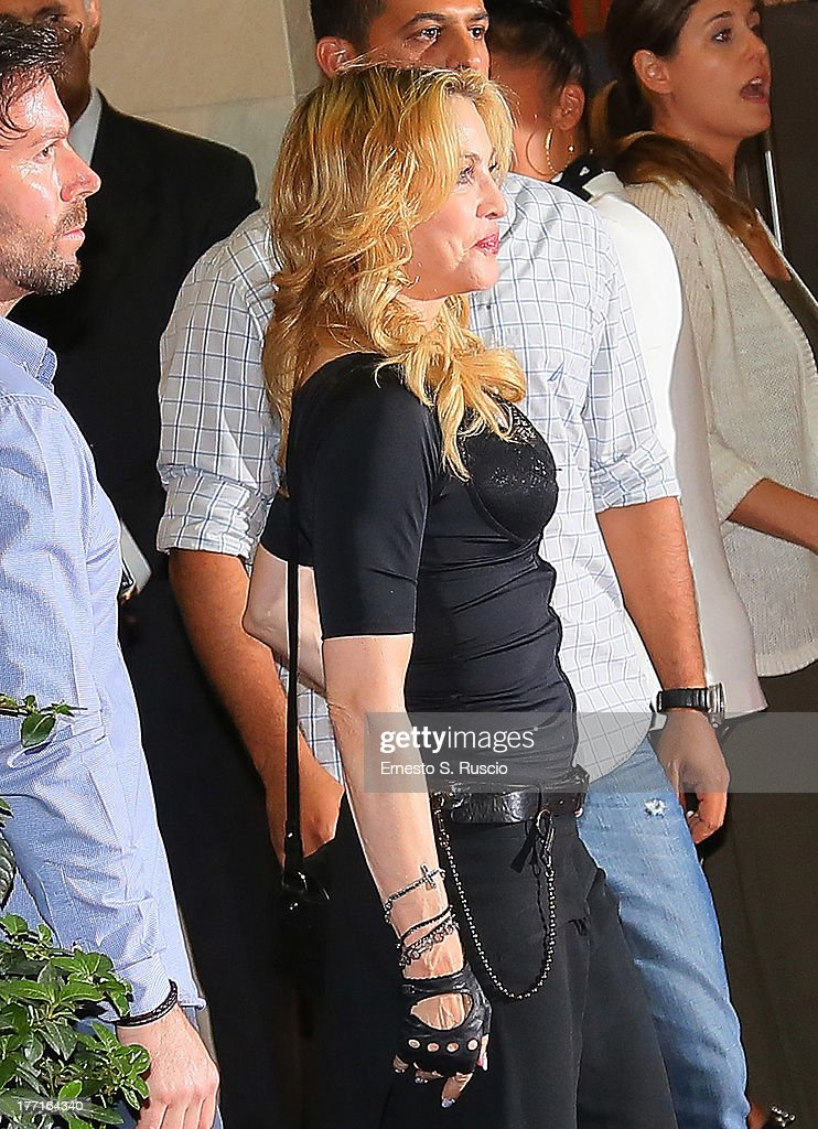 <a gi-track='captionPersonalityLinkClicked' href=/galleries/search?phrase=Madonna+-+Singer&family=editorial&specificpeople=156408 ng-click='$event.stopPropagation()'>Madonna</a> visits the Hard Candy Fitness club at Colosseo on August 21, 2013 in Rome, Italy.