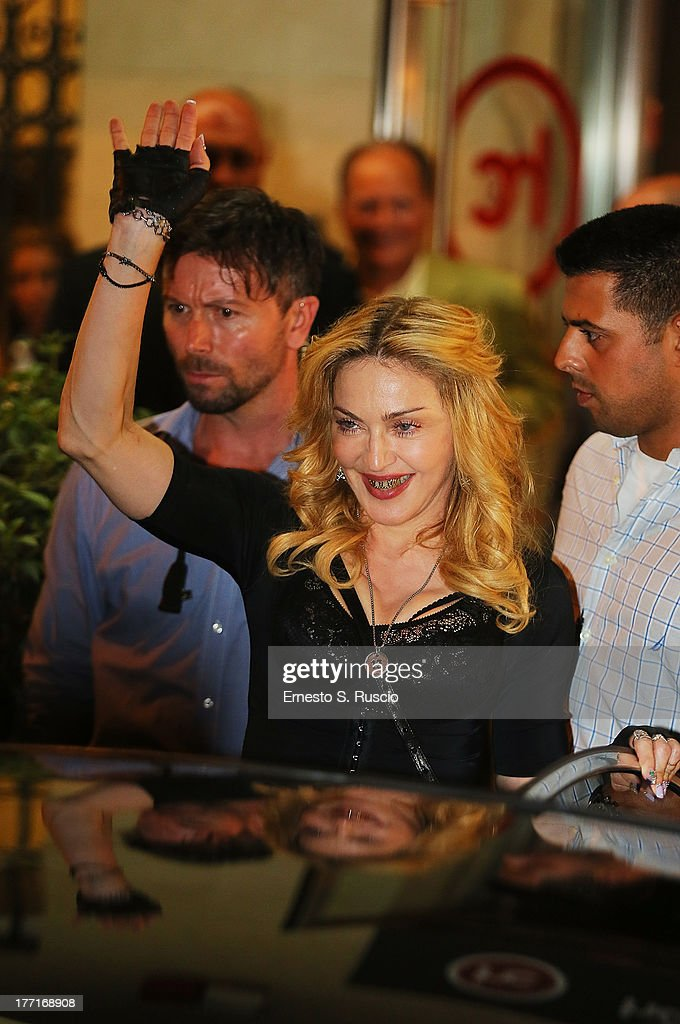 <a gi-track='captionPersonalityLinkClicked' href=/galleries/search?phrase=Madonna+-+Singer&family=editorial&specificpeople=156408 ng-click='$event.stopPropagation()'>Madonna</a> visits the Hard Candy Fitness Roma at Colosseo on August 21, 2013 in Rome, Italy.