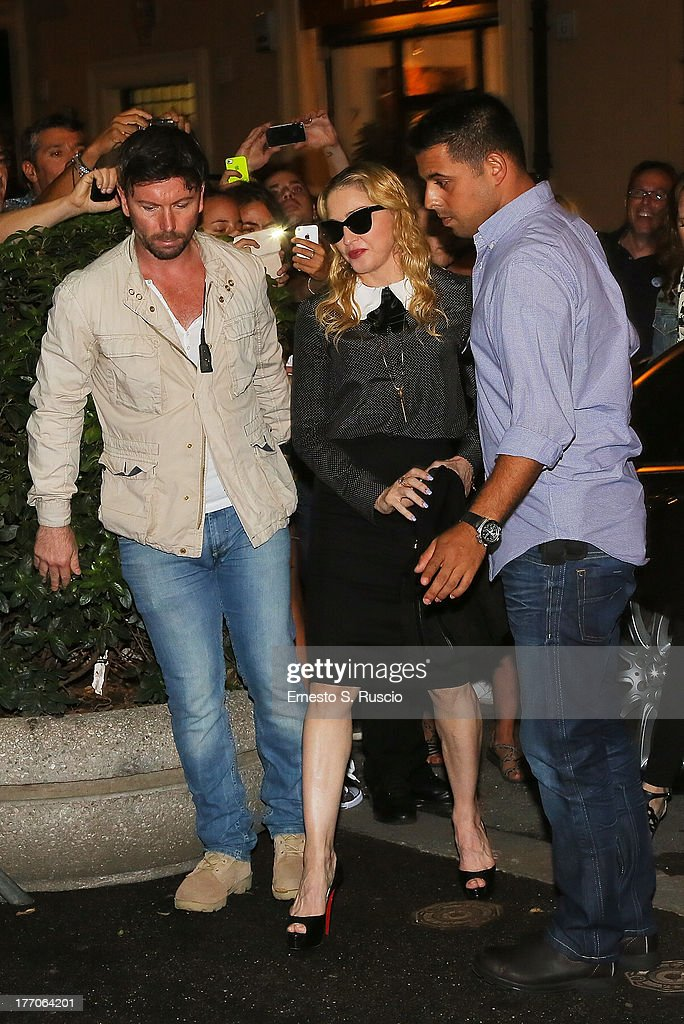 <a gi-track='captionPersonalityLinkClicked' href=/galleries/search?phrase=Madonna+-+Singer&family=editorial&specificpeople=156408 ng-click='$event.stopPropagation()'>Madonna</a> visits the 'The Hard Candy Fitness' at Colosseo on August 20, 2013 in Rome, Italy.