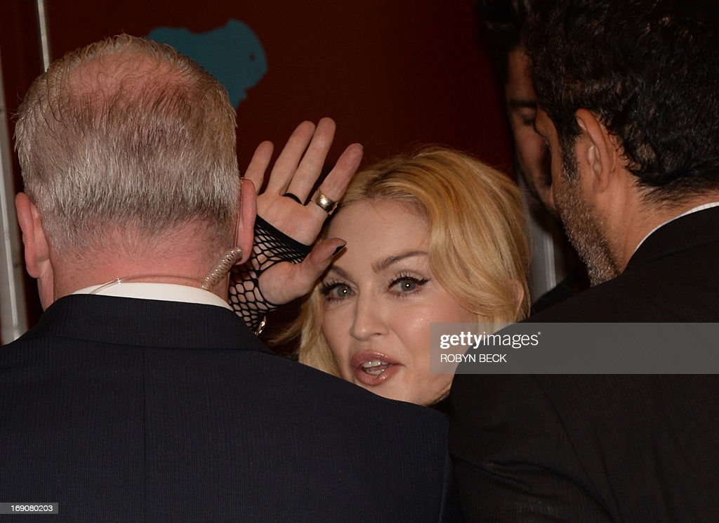Madonna waves as she leaves the press room at the 2013 Billboard Music Awards at the MGM Grand in Las Vegas, Nevada, May 19, 2013. AFP PHOTO / ROBYN BECK