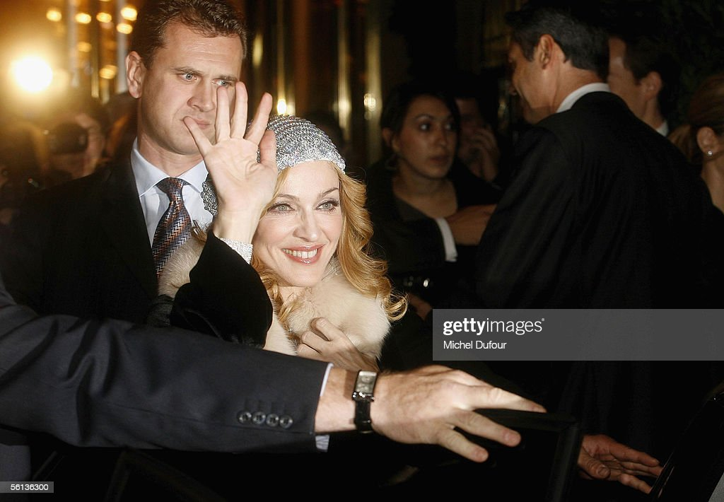 Madonna waves to fans as she leaves the Hotel de Crillon on November 10, 2005 in Paris, France.