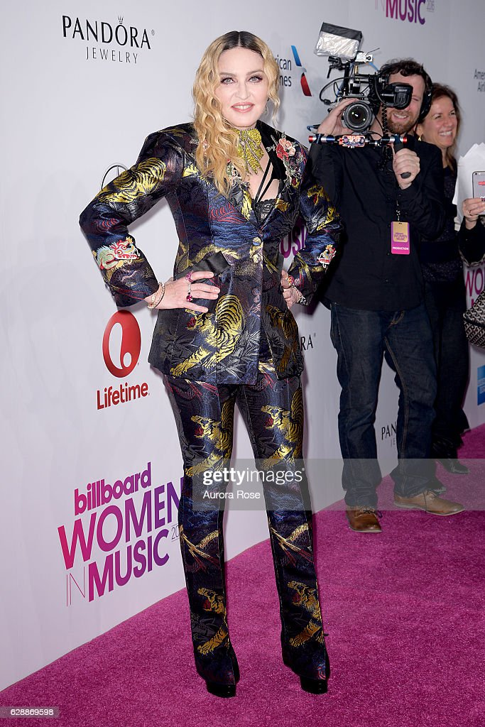 Madonna wearing custom Gucci Suit attends Billboard Women in Music 2016 at Pier 36 on December 9, 2016 in New York City.