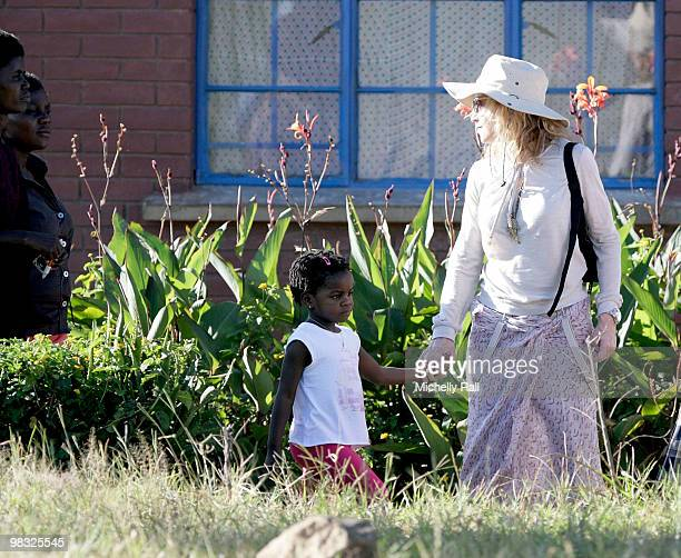 Madonna with adopted Malawian Mercy James at one of the Raising Malawi initiative's Mphandula Childcare Centre which supports over 350 Children from...