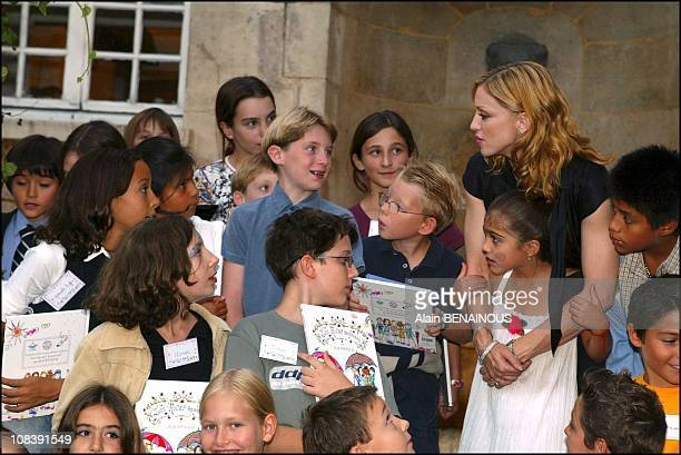 Madonna with children and daughter Lourdes Maria In Paris France on September 15 2003