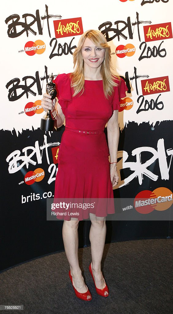 Madonna with her Brit Award for Best International Female Artist at the Earls Court in London, United Kingdom.