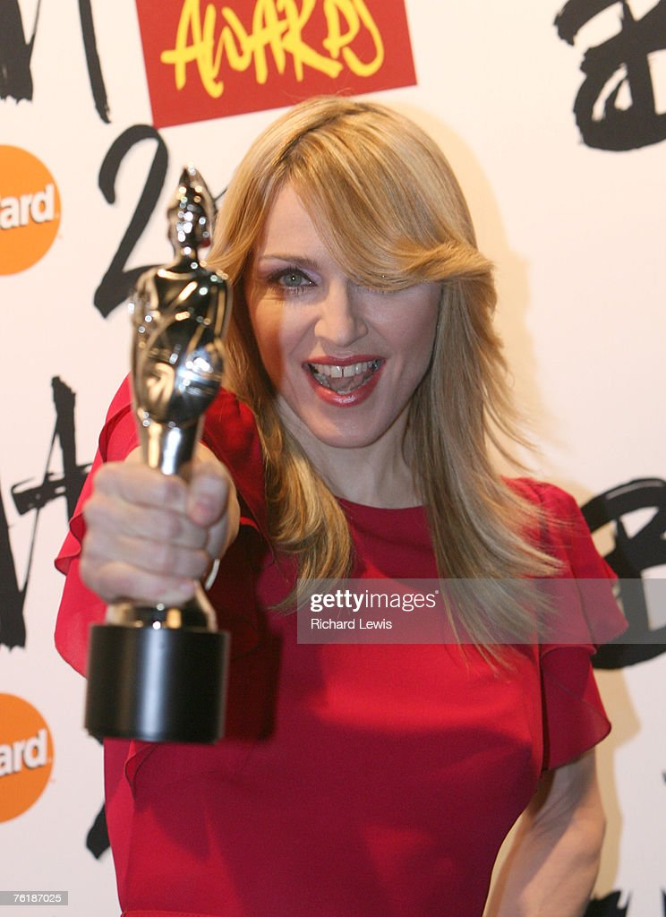 Madonna with her Brit Award for Best International Female Solo Artist