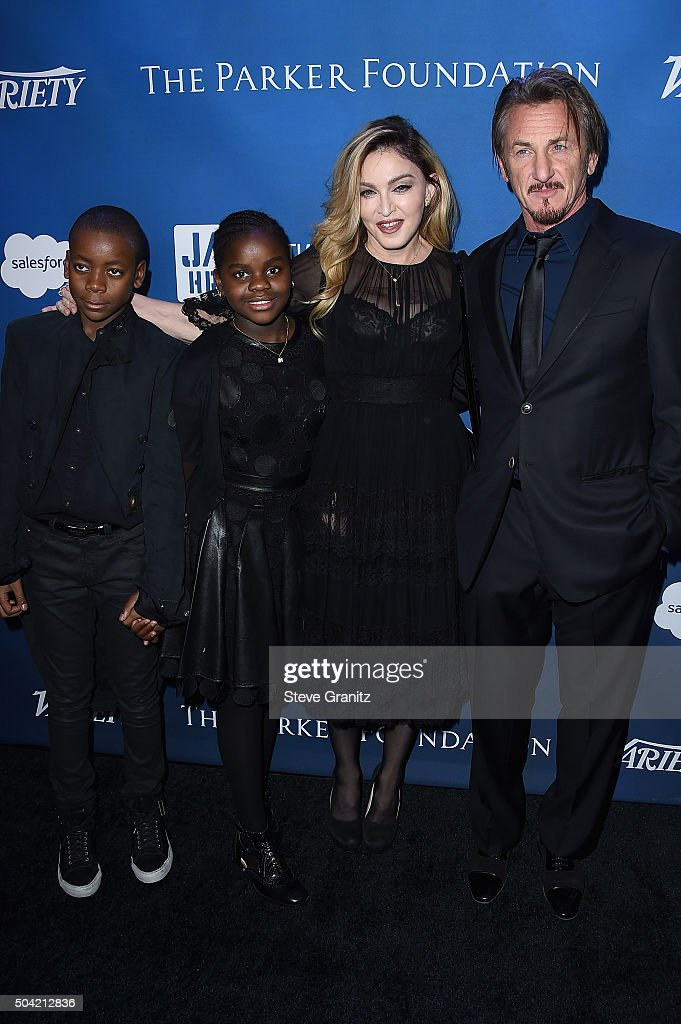 Madonna's kids David Banda, Mercy James, musician Madonna and host Sean Penn attend the 5th Annual Sean Penn & Friends HELP HAITI HOME Gala Benefiting J/P Haitian Relief Organization at Montage Hotel on January 9, 2016 in Beverly Hills, California.