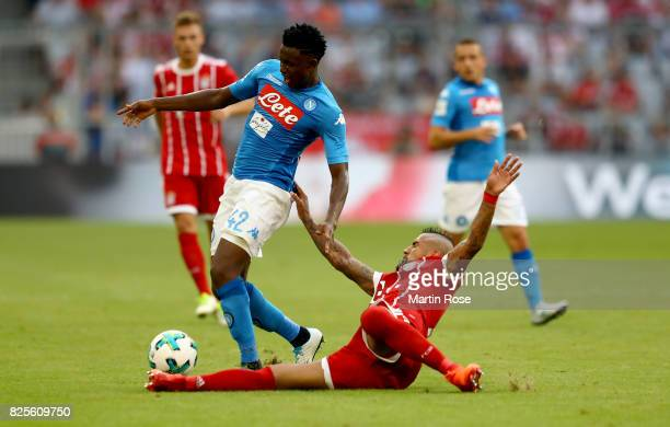 Madou Diawara of Napoloi and Arturo Vidal of Muenchen battle for the ball during the Audi Cup 2017 match between SSC Napoli and FC Bayern Muenchen at...