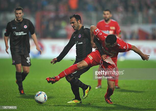 Madouni of Berlin is challenged by Mahir Saglik of St Pauli during the Second Bundesliga match between 1 FC Union Berlin and FC St Pauli at Stadion...