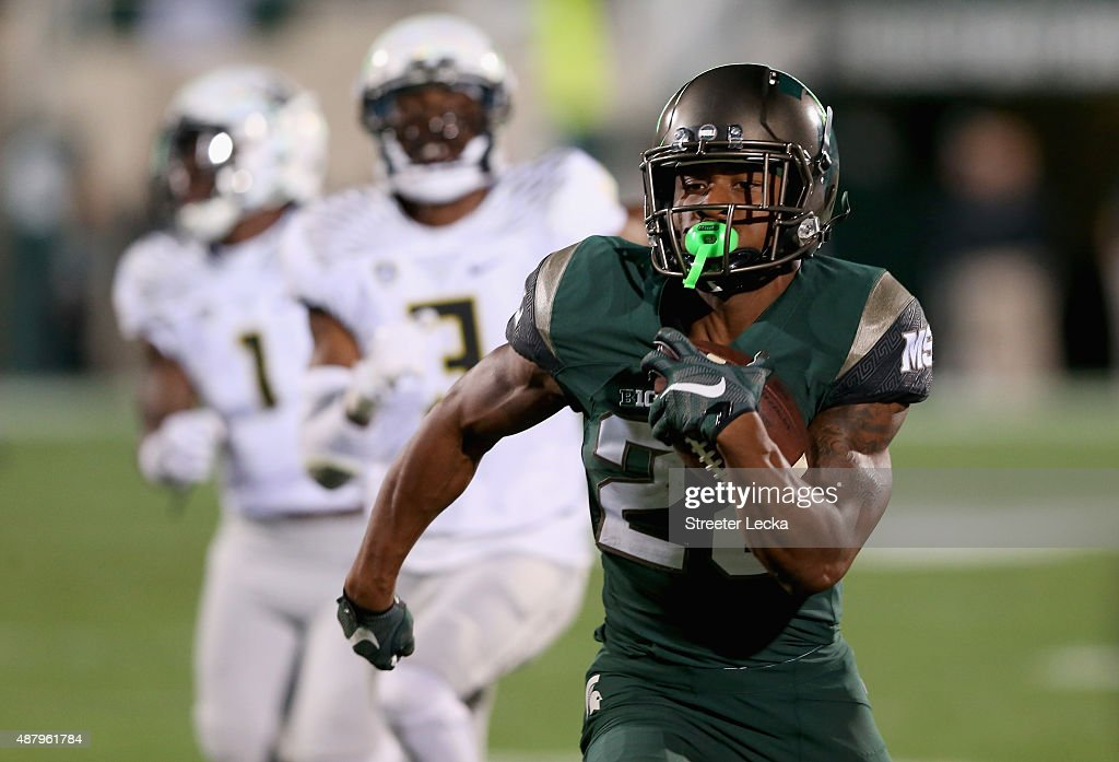 Madre London of the Michigan State Spartans runs with the ball against the Oregon Ducks during their game at Spartan Stadium on September 12 2015 in...
