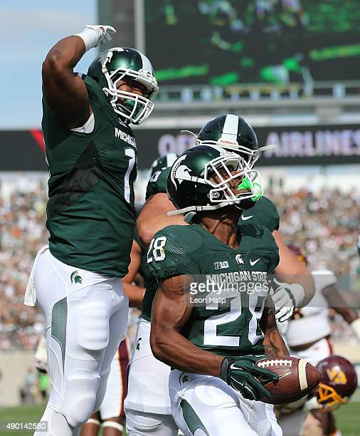Madre London of the Michigan State Spartans scores on a short run during the first quarter of the game against the Central Michigan Chippewas on...