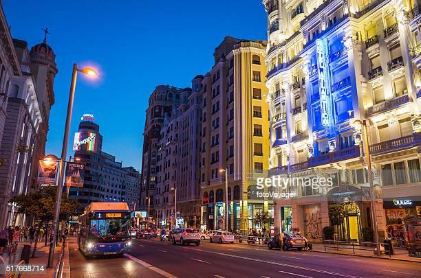 Madrid Gran Via busy shopping street illuminated at dusk Spain