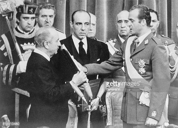 Hand placed on the Bible Prince Juan Carlos takes the oath of his throne in the Cortes Building in Madrid as the monarchy is reintroduced in Spain...