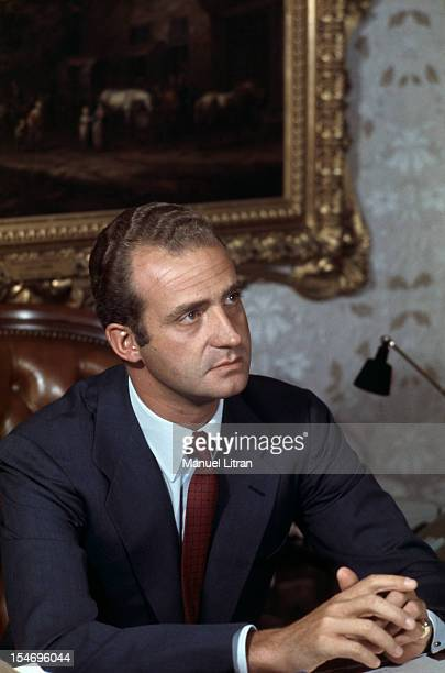 Madrid July 1971 Juan Carlos of Spain sitting behind his desk at home at the Zarzuela Palace
