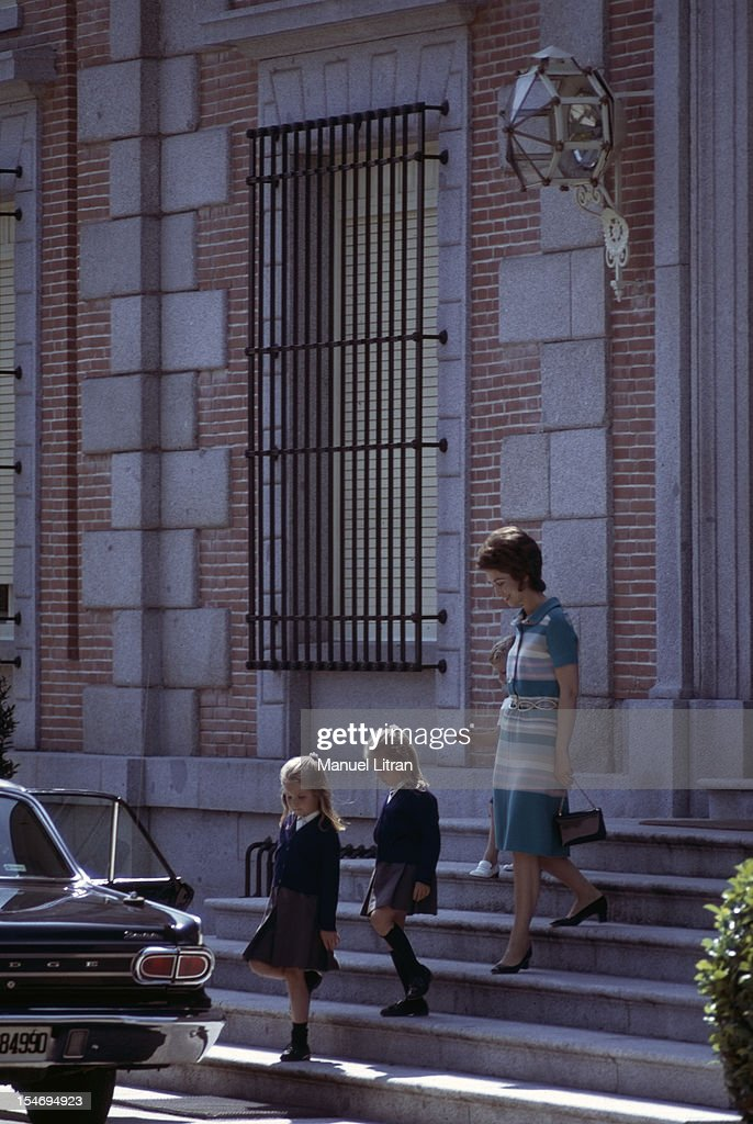 Madrid July 1971 Princess Sophia of Spain and her children the Infanta Elena and Infanta Cristina down the steps of the Zarzuela Palace expected by a...