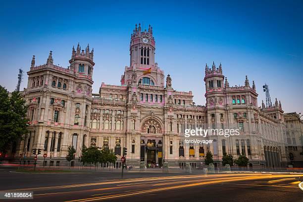 Madrid Palacio de Cibeles traffic zooming through Plaza Cibeles Spain