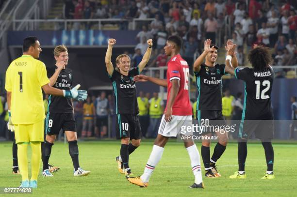 Madrid players celebrate after winning the UEFA Super Cup football match between Real Madrid and Manchester United on August 8 at the Philip II Arena...