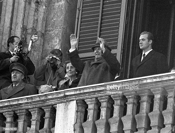 Madrid Spain 17th December 1970 Spanish head of state and dictator General Franco waves from the balcony of the Royal Palace in Madrid with Prince...