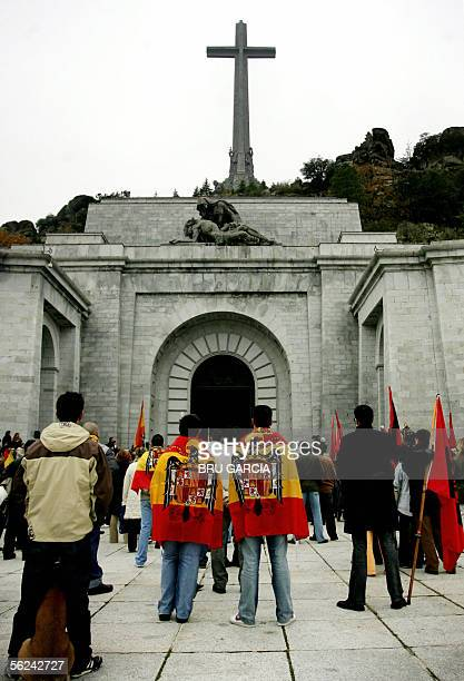 A group of people sporting falangist and fascist flags wait outside the tomb of of Jose Antonio Primo de Rivera founder of the falange party in the...