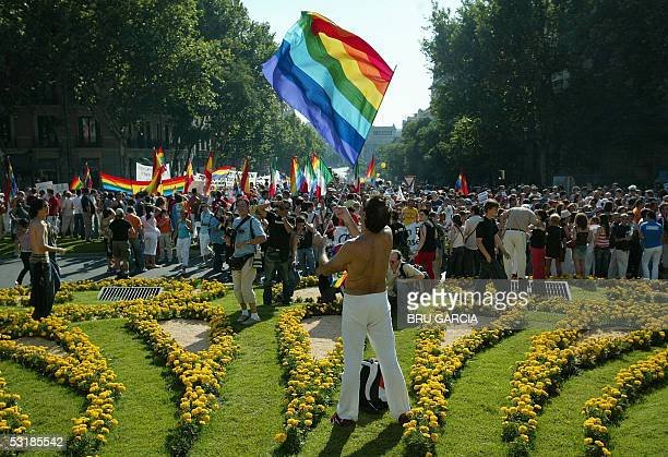 A man holds a rainbow flag during the Gay Pride parade in Madrid 02 July 2005 AFP PHOTO/ Bru GARCIA