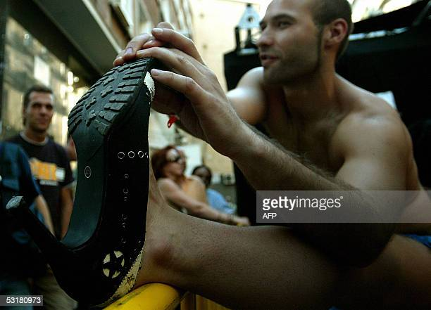 A participant in the highheels race warms up at a gay pride party in the gay neighborhood of Chueca in Madrid 01 July 2005 Spanish gays and lesbians...