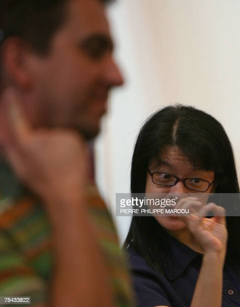 A woman converses in sign language during the XVth World Congress of the World Federation of the Deaf in Madrid 16 July 2007 The conference is hosted...