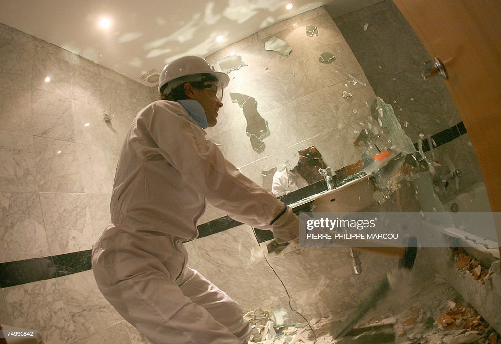 Argentinian Jorge destroys a bathroom in a Madrid's hotel, 03 July 2007. Candidates stressed enough after taken strengh and psychological tests are allowed to take part in the First International 'roomolition' consisting in breaking everything they find in the hotel: bedrooms, bathrooms and common areas.