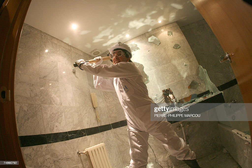 Argentinian Jorge starts destroying a bathroom in a Madrid hotel, 03 July 2007. Candidates stressed enough after taking strength and psychological tests are allowed to take part in the 'roomolition,' consisting in breaking everything they find in the hotel: bedrooms, bathrooms and common areas.