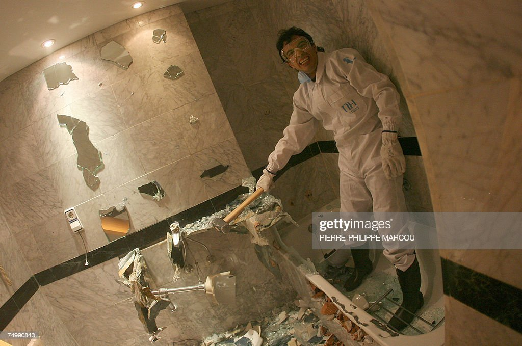 Argentinian Jorge takes a break after destroying a bathroom in a Madrid hotel, 03 July 2007. Candidates stressed enough after taking strength and psychological tests are allowed to take part in the 'roomolition,' consisting in breaking everything they find in the hotel: bedrooms, bathrooms and common areas.