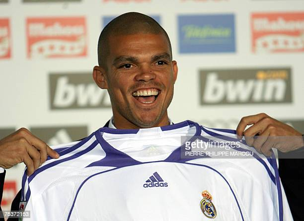 Real Madrid Football Club's new midfielder Brazilian Kleper Laveran de Lima Ferreira aka 'Pepe' poses with his new jersey during his presentation at...
