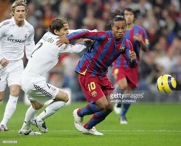 Real Madrid's Michel Salgado vies with Barcelona's Ronaldinho during their Spanish League football match at Santiago Bernabeu stadium in Madrid 19...