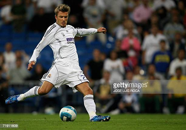 Real Madrids player David Beckham shoots during their Spanish League match against Real Sociedad at Santiago Bernabeu stadium in Madrid 17 September...