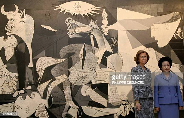 Spain's Queen Sofia and Kwon Yangsook the wife of the South Korean President pose in front of the Picasso's 'Guernica' at the Reina Sofia museum in...