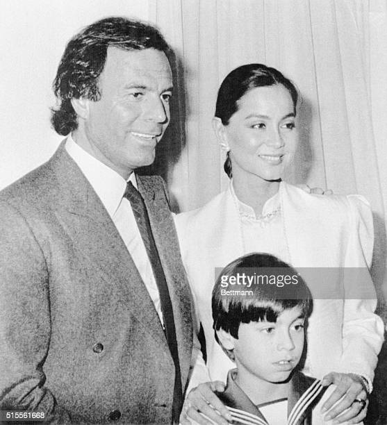Spanish singer Julio Iglesias joins his estranged wife Isabel Preysler on the eve of their son Enrique Migiel's first communion Julio and Isabel were...