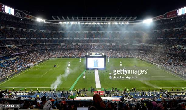 Madrid team shows the cup to the audience during the Real Madrid fireworks ceremony after winning the UEFA Champions League Final at Santiago...