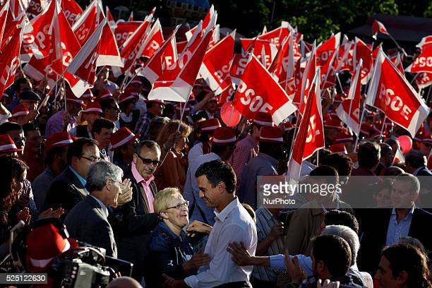 The leader of the Spanish Socialist Pedro Sanchez greets a person on arrival at the final campaign meeting in Madrid on May 22 2015