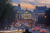 Madrid, View of Calle de Alcala and Plaza de Cibeles, Edificio Metropolis blurred traffic at dusk