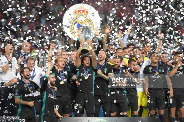 Madrid's players celebrate with the trophy after winning the UEFA Super Cup football match between Real Madrid and Manchester United on August 8 at...
