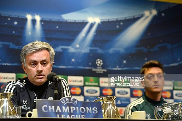 Madrid´s Portuguese head coach Jose Morinho and Madrid 's German midfielder Mesut Oezil attend a press conference in Dortmund western Germany on...