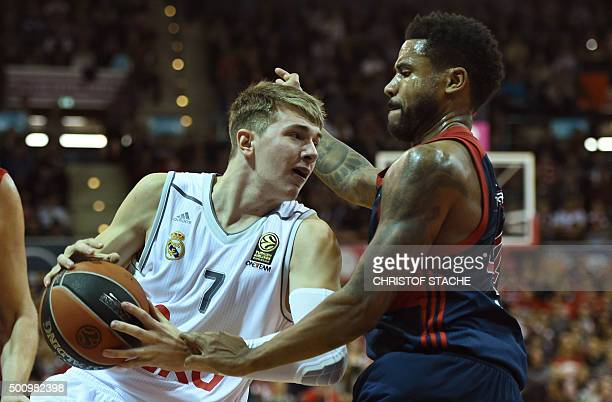 Madrid's Slovenian guard Luka Doncic and Bayern Munich's US guard Bryce Taylor vie for the ball during the EuroLeague Group A basketball match FC...
