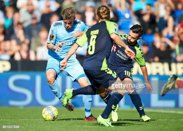 Mads Agesen of Randers FC and Besar Halimi of Brondby IF compete for the ball during the Danish Alka Superliga match between Randers FC and Brondby...